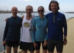 "Club members Rinaldo ""Fulmine Trentino"" Cis and Dan Aspromonte celebrate with fellow Italians  Elena Fasolo and Mattia,Borsalino at the Santa  Cruz Harbor after the Wharf-to-Wharf Race"