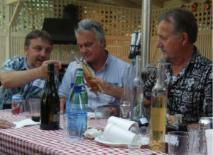 Lino Rizzi offering his exquisite homemade grappas to Tesino visitors Roberto Biasion on the left and Francesco Gasperini on the right at the Yob's in September